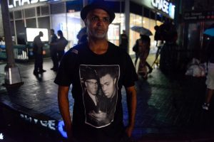 A man wears a t-shirt with a photo of Muhammad Ali during a tribute in Harlem, New York. REUTERS/Stephanie Keith