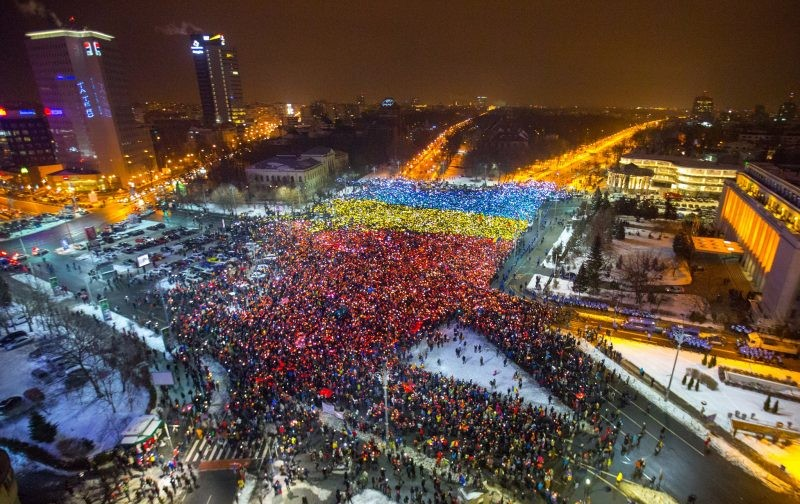 The Romanian flag took its toll over Victoriei Square during the 13th consecutive day of protests in Bucharest