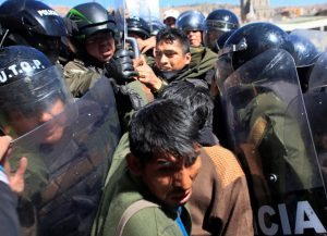 Demonstrators with physical disabilities clash with riot police during a rally protest in La Paz