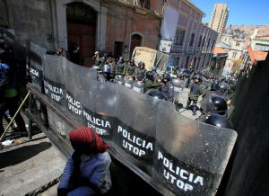 Riot police guard one of the entrances to Murillo square, during a protest by people with physical disabilities demanding the government to increase their monthly disability subsidy, in La Paz