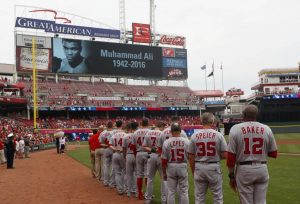 The Washington Nationals stand on the field during a moment of remembrance for Muhammad Ali before a game against the Cincinnati Reds at Great American Ball Park. David Kohl-USA TODAY Sports