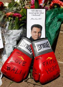 Fans of Muhammad Ali leave personal mementos as they pay their respects at the Ali Center in Louisville, Kentucky. REUTERS/John Sommers II