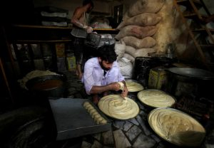 A baker prepares dough for bread ahead of Ramadan in Peshawar, Pakistan, May 31, 2016. REUTERS/Fayaz Aziz