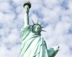 Fourth of July Special: Woman Climbs the Statue of Liberty to Protest