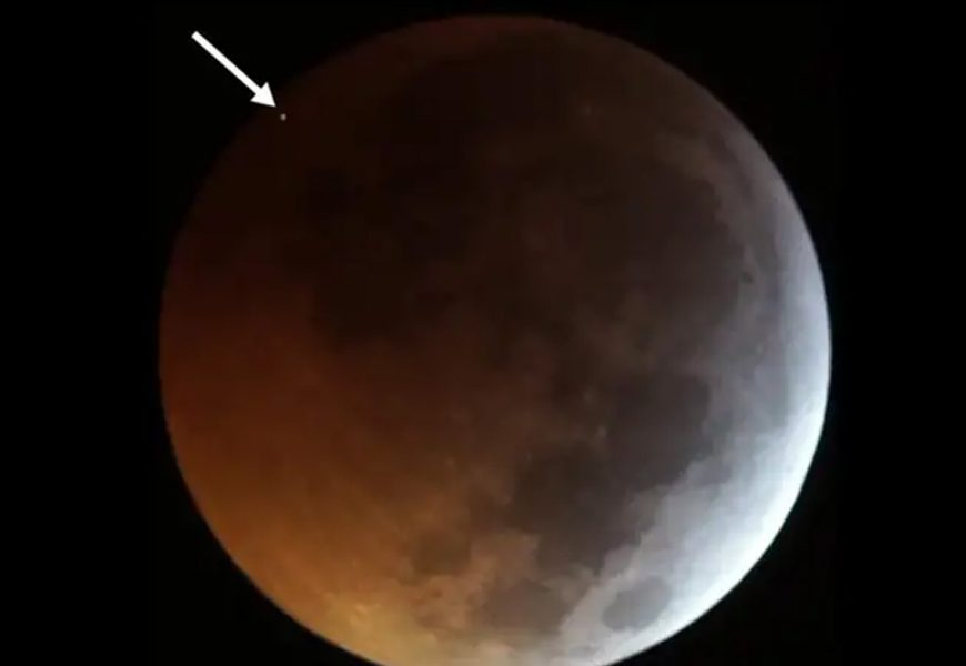 Telescopes capture the moment of a meteor impact during lunar eclipse