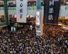 Hong Kong Protests Causes Flights To Be Cancelled and Roads To Be Blocked