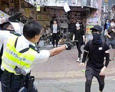 Hong Kong police shoot protester at close range, man set on fire in escalating violence